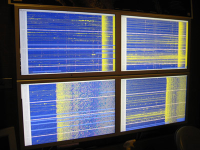 Photo of monitors displaying real time waveforms              created by the Alaska and Peru earthquakes of August 15, 2007
